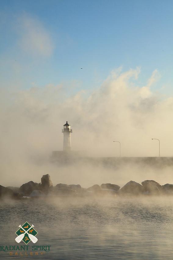 """Lighthouse in Sea Smoke""<br /> <br /> Sea smoke (steam devils) were abundant on Lake Superior on this subzero morning in Duluth, Minnesota."
