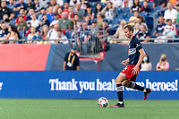 FOXBOROUGH, MA - AUGUST 18: Henry Kessler #4 of New England Revolution passes the ball during a game between D.C. United and New England Revolution at Gillette Stadium on August 18, 2021 in Foxborough, Massachusetts.