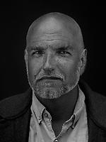 Portrait made using ultraviolet light of VII photographer John Stanmeyer.
