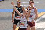 A marathoner celebrates his personal victory after crossing the finish line of the Rome Marathon on March 18, 2007.