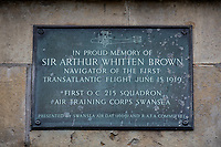 Pictured: A plaque in tribute to Arthur Brown who lived in Belgrave Court, Swansea, Wales, UK. Thursday 13 June 2019<br /> Re: It has been 100 years since British aviators John Alcock and Arthur Brown made the first non-stop transatlantic flight in June 1919. They flew a modified First World War Vickers Vimy bomber from St. John's, Newfoundland, to Clifden, Connemara, County Galway, Ireland.<br /> They took off at around 1:45 p.m. on 14 June and crash-landed at 8:40 a.m. on 15 June 1919 in Ireland.<br /> During the flight, the wind-driven electrical generator failed, depriving them of radio contact, their intercom and heating. An exhaust pipe burst shortly afterwards, causing a frightening noise which made conversation impossible without the failed intercom.<br /> Alcock twice lost control of the aircraft and nearly hit the sea after a spiral dive. He also had to deal with a broken trim control that made the plane become very nose-heavy as fuel was consumed.