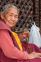 Bodhnath, Nepal.  Old Nepali Man, a Buddhist Monk, with Prayer Beads.
