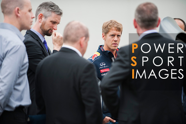 Formula One Triple World Champion and Infiniti Red Bull Racing driver Sebastian Vettel  at the European Technical Center on 25 June 2013 in Cranfield, United Kingdom. In his role as Infiniti Director of Performance, Vettel was joined by Infiniti Red Bull Racing Head of R&D Projects Rob Gray to discuss the 2014 F1 technical regulations with Infiniti's top engineers at Infiniti's UK facility. Photo by Victor Fraile / The Power of Sport Images for Infiniti