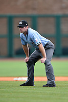 Field umpire Bryan Fields during a game between the Corpus Christi Hooks and NW Arkansas Naturals on May 26, 2014 at Arvest Ballpark in Springdale, Arkansas.  NW Arkansas defeated Corpus Christi 5-3.  (Mike Janes/Four Seam Images)