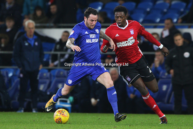 Ipswich Town manager Mick McCarthy watches on as Lee Tomlin of Cardiff City is marked by Dominic Iorfa of Ipswich during the Sky Bet Championship match between Cardiff City and Ipswich Town at The Cardiff City Stadium, Cardiff, Wales, UK. Tuesday 31 October 2017