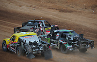 Mar. 20, 2011; Chandler, AZ, USA;  LOORRS pro two driver Brian Deegan (38) spins in front of Rob Naughton (54) and Jeremy McGrath (2) during round two at Firebird International Raceway. Mandatory Credit: Mark J. Rebilas-