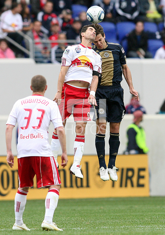 Cristian Arrieta #26 of the Philadelphia Union heads the ball with Juan Pablo Angel #9 of the New York RedBulls during a MLS  match on April 24 2010, at RedBull Arena, in Harrison, New Jersey.