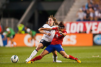 United States (USA) midfielder Heather O'Reilly (9) and Korea Republic (KOR) defender Cho Sohyun (8). The women's national team of the United States defeated the Korea Republic 5-0 during an international friendly at Red Bull Arena in Harrison, NJ, on June 20, 2013.