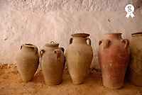 Tunisia, Matmata, terra cotta jars against wall inside troglodyte home (Licence this image exclusively with Getty: http://www.gettyimages.com/detail/sb10065474dp-001 )