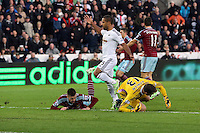 Pictured: Wayne Routledge of Swansea (C) has his shot stoped by Adrian (R) goalkeeper for West Ham Saturday 10 January 2015<br /> Re: Barclays Premier League, Swansea City FC v West Ham United at the Liberty Stadium, south Wales, UK
