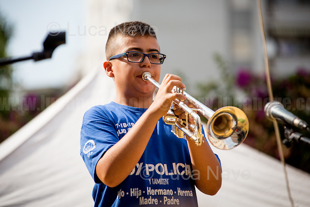 """Schoolchild plays """"Il Silenzio"""" (by Nini Rosso - https://www.youtube.com/watch?v=UF_LyEpcfKo ).<br /> <br /> Palermo (Sicily - Italy), 19/07/2017. """"Basta depistaggi e omertà di Stato!"""" (""""Stop disinformation & omertá by the State!"""")(1). Public event to commemorate the 25th Anniversary of the assassination of the anti-mafia Magistrate Paolo Borsellino along with five of his police """"scorta"""" (Escorts from the special branch of the Italian police force who protect Judges): Agostino Catalano, Emanuela Loi (The first Italian female member of the police special branch and the first woman of this branch to be killed on duty), Vincenzo Li Muli, Walter Eddie Cosina and Claudio Traina. The event was held at Via D'Amelio, the road where Borsellino was killed. Family members of mafia victims, amongst others, made speeches about their dramatic experiences, mafia violence and unpunished crimes, State cover-ups, silence ('omertá'), and misinformation. Speakers included, amongst others, Vincenzo Agostino & Augusta Schiera, Salvatore & Cristina Catalano, Graziella Accetta, Massimo Sole, Paola Caccia, Luciano Traina, Angela Manca, Stefano Mormile, Ferdinando Imposimato, Judge Nino Di Matteo. The event ended with the screening of the RAI docu-fiction, 'Adesso Tocca A Me' ('Now it's My Turn' - Watch it here: http://bit.ly/2w3WJUX ).<br /> <br /> For more info & a video of the event please click here: http://bit.ly/2eQfNT3 & http://bit.ly/2eQbmrj & http://19luglio1992.com & http://bit.ly/2he8hCj<br /> <br /> (1) 'Omerta' is the term used in Italy to refer to the code of silence used by mafia organisations, as well as the culture of silence that is entrenched in society at large (especially among victims of mafia crimes, as they fear recriminations), about the existence of organised crime and its activities."""