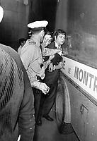 1968 FILE PHOTO - ARCHIVES <br /> <br /> L'emeute de la Saint-Jean-Baptiste du 24 juin 1968.<br /> <br /> 290 personnes sont arretees pour desobeissance civile.  C'est le lundi de la matraque<br /> <br /> Montreal rioter is pushed against one of the estimated 10 paddy wagons the police had along the parade in anticipation there would be violence last night.<br /> <br /> PHOTO :  Jeff Goode - Toronto Star Archives - AQP