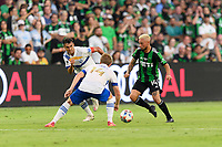 AUSTIN, TX - JUNE 19: Diego Fagundez #14 of Austin FC attempts to dribble the ball through Chris Wondolowski #8 and Jackson Yueill #14 of the SJ Earthquakes during a game between San Jose Earthquakes and Austin FC at Q2 Stadium on June 19, 2021 in Austin, Texas.