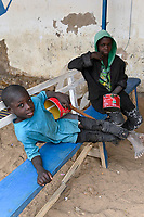 MALI, Kayes, Talibé boys, children belong to a quranic school daara beg with tomato tin can for their islamic teacher /  junge Koranschueler einer Koranschule betteln fuer ihren Marabout, islamischen Lehrer