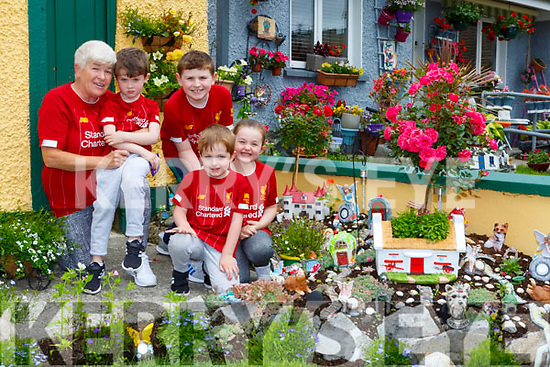 Antoinette O'Shea with her grandchildren l-r: Eoghan Breen, Jack Breen, Nathan and Roisin Moloney-Murphy in their beautiful fairy garden they made in Torc Terrace