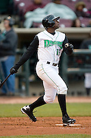 Byron Wiley #15 of the Dayton Dragons follows through on his swing versus the Great Lakes Loons at Fifth Third Field April 21, 2009 in Dayton, Ohio. (Photo by Brian Westerholt / Four Seam Images)