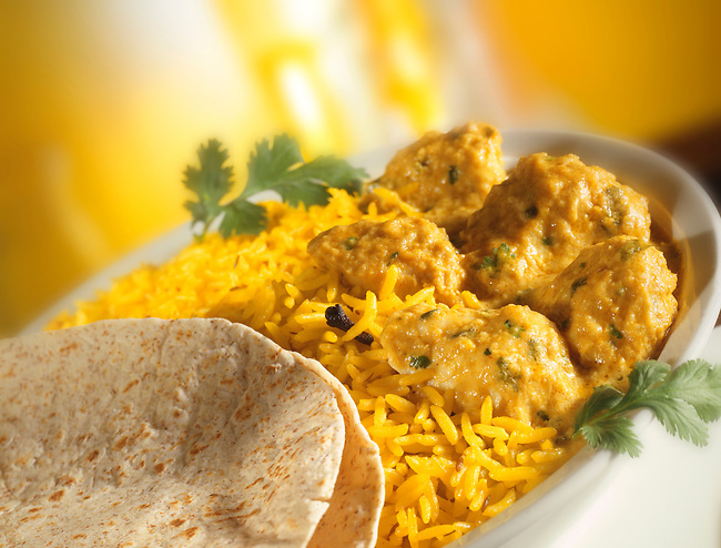 Chicken Korma, pilau rice, naan bread in a white dish. yellow background  Indian food stock pictures, photos fotos & images