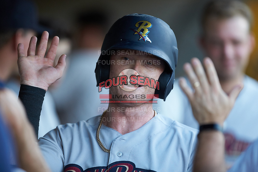Clint Frazier (77) of the Scranton/Wilkes-Barre RailRiders is congratulated by his teammates after scoring a run against the Gwinnett Stripers at Coolray Field on August 16, 2019 in Lawrenceville, Georgia. The Stripers defeated the RailRiders 5-2. (Brian Westerholt/Four Seam Images)