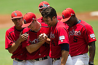 Stony Brook Seawolves pitcher Tyler Johnson #44 is mobbed by his teammates following his 3 hit complete game victory at the NCAA Super Regional baseball game against LSU on June 9, 2012 at Alex Box Stadium in Baton Rouge, Louisiana. Stony Brook defeated LSU 3-1. (Andrew Woolley/Four Seam Images)