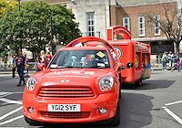 July 21, 2012: A Mini Cooper and a Coca-Cola beverage carriage is parked at the intersection of Albion Road and Church Street close to St Mary's Church located in the town of Stoke Newington in London, England.