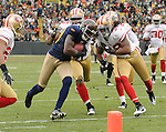 Green Bay Packers receiver Donald Driver, center, runs to the goal line to score near San Francisco 49ers' Dashon Goldson during the third quarter of the game at Lambeau Field in Green Bay, Wis., on Dec. 5, 2010.