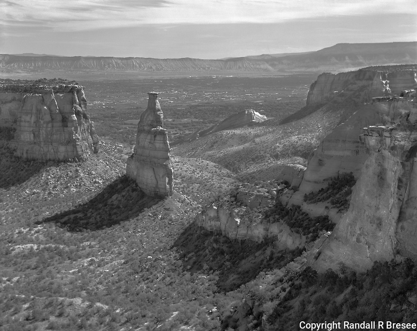 """""""Monuments Along Rim Rock Drive""""<br /> Colorado National Monument, Colorado<br /> <br /> Colorado National Monument is located a short distance off I-70 near the Colorado-Utah border. Rim Rock Drive is a 23 mile long paved road that takes visitors past much natural beauty. This photograph shows some of the stone monuments that are easily seen in Colorado National Monument."""