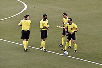 KANSAS CITY, KS - SEPTEMBER 23: the referee team split up before the match during a game between Orlando City SC and Sporting Kansas City at Children's Mercy Park on September 23, 2020 in Kansas City, Kansas.