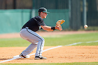 Zach Remillard (7) of the Coastal Carolina Chanticleers waits for a throw at third base during the game against the High Point Panthers at Willard Stadium on March 15, 2014 in High Point, North Carolina.  The Chanticleers defeated the Panthers 1-0 in the first game of a double-header.  (Brian Westerholt/Four Seam Images)