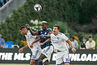 FOXBOROUGH, MA - JULY 27:  Tesho Akindele #13, Wilfried Zahibo #23 and Sacha Kljestan #16 compete for a high ball at Gillette Stadium on July 27, 2019 in Foxborough, Massachusetts.