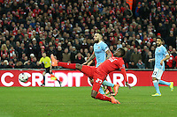 Divock Origi of Liverpool stretches to reach the ball during the Capital One Cup match between Liverpool and Manchester City at Wembley Stadium, London, England on 28 February 2016. Photo by David Horn / PRiME Media Images.