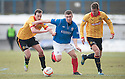 Cowdenbeath's Craig Moore gets away from Thistle's Stuart Bannigan and Thistle's Aaron Muirhead.