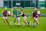 Jack Sullivan of Ballyduff been bottled up by Bryan Murphy and Jason Diggins in round 2 of the County Senior Hurling championship,