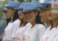 """A group of young Korean women greeted spectators with """"Welcome to smiling Korea!"""" in English before entering the World Cup Opening Day Eve Festivities taking place in  Seoul, South Korea on Thursday May 30th, 2002. The World Cup will begin on Friday in Seoul with a match between defending champions France vs. Senegal."""