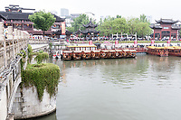 Nanjing, Jiangsu, China.  Confucius Temple Area. Tourist Boats on the Qinhuai River Waiting in the Rain.