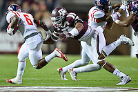 Texas A&M defensive back Victor Davis (28) attempts to bring down Ole Miss running back Jaylen Walton (6) during first half of an NCAA football game, Saturday, October 11, 2014 in College Station, Tex. Ole Miss leads Texas A&M 21-0 at the halftime. (Mo Khursheed/TFV Media via AP Images)