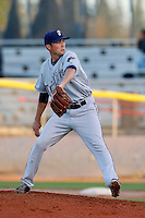 Shane Broyles of the Tri-City Dust Devils pitches against the Salem-Keizer Volcanoes at Volcanoes Stadium on July 27, 2013 in Keizer, Oregon. Tri-City defeated Salem-Keizer, 5-4. (Larry Goren/Four Seam Images)
