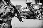 Afghan police patrol the streets of Jalalabad, 01 October 2013. (John D McHugh)