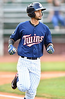 Elizabethton Twins center fielder Gilberto Celestino (25) runs to first base during a game against the Kingsport Mets at Joe O'Brien Field on August 7, 2018 in Elizabethton, Tennessee. The Twins defeated the Mets 16-10. (Tony Farlow/Four Seam Images)