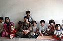 Iraq 1991  Women and children coming back from Iran and living in a dilapidated house of Halabja   Irak 1991  Femmes et enfants de retour d'exil en Iran vivant dans une maison delabree d'Halabja