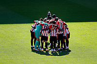 6th September 2020; Griffin Park, London, England; English Football League Cup, Carabao Cup, Football, Brentford FC versus Wycombe Wanderers; Brentford starting eleven huddle up before kick off