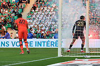 25th September 2021; Saint-Etienne Stade Geoffroy Guichard, France; AS Saint-Etienne versus OGC Nice; A smoke bomb is removed from the pitch by Jean-Clair TODIBO