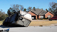 Marc Hayot/Herald-Leader<br /> A recreational vehicle was overturned at 606 Carter Dr. in the Stonecrest subdivision on the east side of Siloam Springs after severe thunderstorms hit the area during the early hours of Monday morning.