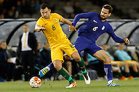 June 7, 2016: BAILEY WRIGHT (8) of Australia and ALEXANDROS TZIOLIS (6) of Greece fight for the ball during an international friendly match between the Australian Socceroos and Greece at Etihad Stadium, Melbourne. Photo Sydney Low