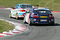 Round 1 of the 2006 British Touring car Championship. #77 Mike Jordan (GBR). Team Eurotech. Honda Integra Type-R & #15 Martyn Bell (GBR). Geoff Steel Racing. BMW E46 320i.