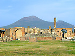 The Temple of Jupiter at the city of Pompeii with Mount Vesuvius in the background. (Italy)