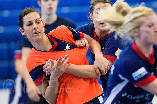06 APR 2012 - LONDON, GBR - Ewa Palies (second from right, part hidden) tries to mark Daniela Sposi (in orange) during a training game for the Great Britain women's handball team at the National Sports Centre in Crystal Palace, Great Britain .(PHOTO (C) 2012 NIGEL FARROW)