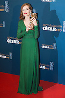 """French actress Isabelle Huppert poses with her trophy during a photocall after winning the Best Actress award for """"Elle"""" during the 42nd edition of the Cesar Ceremony at the Salle Pleyel in Paris on February 24, 2017."""