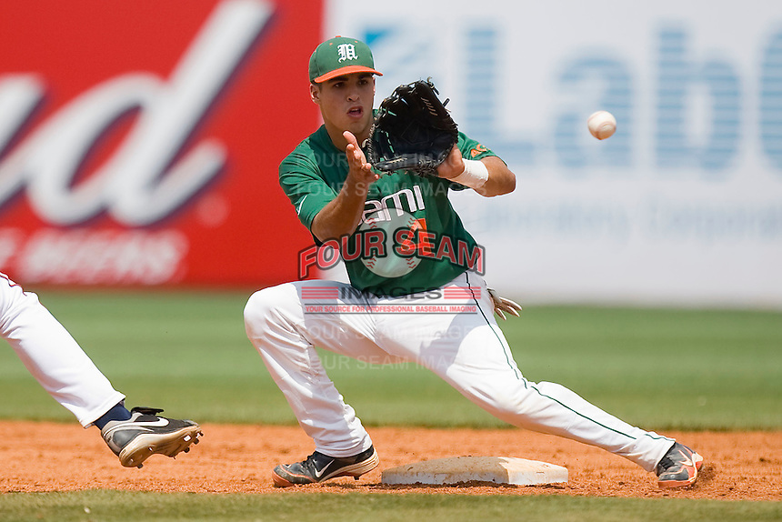 Shortstop Stephen Perez #4 waits for a pick-off throw at second base against the Virginia Cavaliers at the 2010 ACC Baseball Tournament at NewBridge Bank Park May 29, 2010, in Greensboro, North Carolina.  The Cavaliers defeated the Hurricanes 12-8.  Photo by Brian Westerholt / Four Seam Images