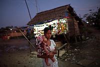 A woman walks through the Hlaing Thaya slum district of Yangon.