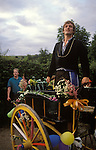 Kilburn Feast Yorkshire July 1980s. Procession Mock Mayor, with Mollie, a man dressed as a woman some times know as Lady Mayoress.  The flower decorated cart is pulled through one street in the village.